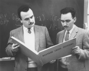 "A.D.B Woods and B.N. Brockhouse look up a neutron cross section in the ""Barn Book"". The work on alkali halides, carried out by Bert Brockhouse, Dave Woods and Bill Cochran, led to the famous shell model."