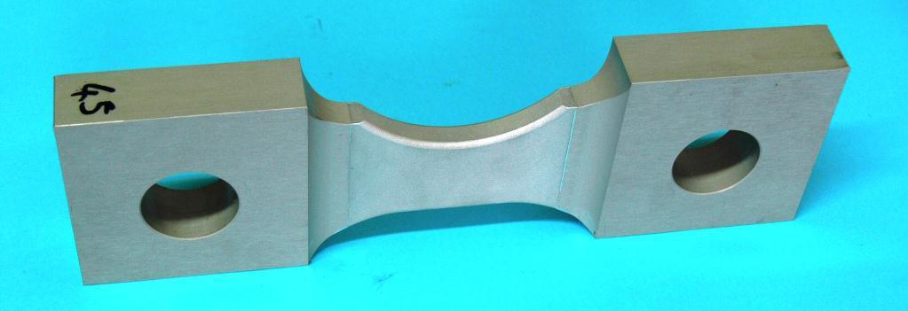 An aluminum specimen with a milled notch and surface treatments ready for examination with neutron beams at the CNBC