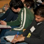 Students taking notes about the power of neutron beams during lectures. (image: NRC)